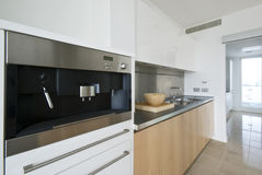 Contemporary kitchen with built in coffee machine stock photo