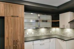 Contemporary kitchen cabinet ensemble Stock Images