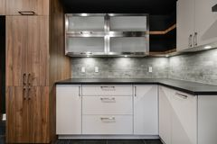 Contemporary kitchen cabinet ensemble front view Royalty Free Stock Image