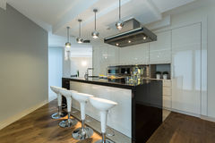 Contemporary kitchen with designer chairs royalty free stock photo