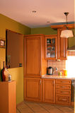 Contemporary kitchen interior. Beautiful interior of contemporary kitchen with wood cabinetry Royalty Free Stock Photo