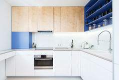 Contemporary kitchen interior. Modern kitchen interior - blue and white combination Royalty Free Stock Images