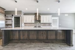 Contemporary kitchen with big island. stock photos