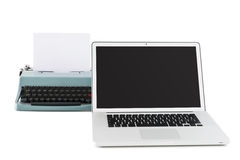 Contemporary laptop in front of an old typewriter Stock Photography