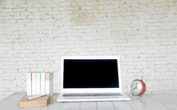 Stock photo :Front view of laptop on wood table in old office i royalty free stock image