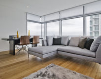 Contemporary living room. With floor to ceiling windows Royalty Free Stock Photo