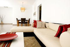 Contemporary living room. Filled with large sofa and dining set Royalty Free Stock Photo