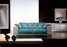 Contemporary living room with blue sofa
