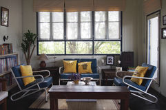 Contemporary living room. With navy sofa and yellow pillow Royalty Free Stock Photos