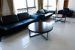 Contemporary lounge. With sofa and tables Stock Image