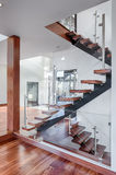 Contemporary Mahogany stairs new house view from behind Stock Photo