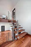 Contemporary Mahogany stairs in new house view from landing Stock Photo