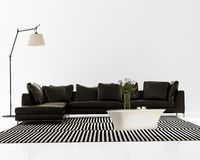 Contemporary minimal black leather sofa. With striped rug and floor lamp royalty free stock images