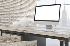 Contemporary office room with city view closeup. Contemporary office room interior with blank computer, other items on desk and bright city view. Close up, Mock Royalty Free Stock Photo