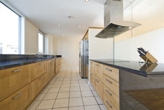 Contemporary open plan kitchen royalty free stock photo