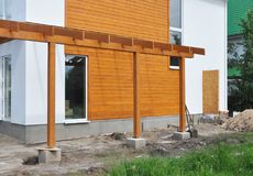 Contemporary Outdoor Terrace. Modern Home Construction with wooden pillars  terrace patio installation Stock Photography