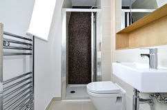 Contemporary 3 piece en-suite bathroom. Contemporary three piece ensuite bathroom with shower cubicle and mosaic tiles royalty free stock images