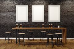 Contemporary pub with blank billboards. Contemporary black brick pub or bar interior with blank billboards on wall. Mock up, 3D Rendering Royalty Free Stock Images