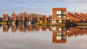 Contemporary residential houses on the waterfront Stock Photos