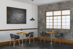 Contemporary restaurant interior side. Side view of contemporary restaurant interior with empty chalkboards, lighting, furniture and window with city view. Mock Stock Images