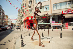 Contemporary sculpture of metal in the form of a traveling man with a lantern in Istanbul Royalty Free Stock Image