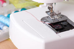 Sewing Machine and Spools of Thread Royalty Free Stock Images