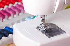 Contemporary Sewing Machine and Spools Stock Images