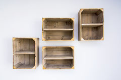 Contemporary shelves made of wooden vegetable boxes. Trendy hipster idea for apartment royalty free stock photos