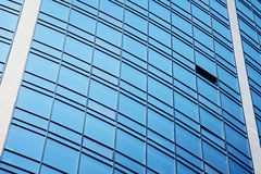 Contemporary skyscraper with glass windows Royalty Free Stock Image