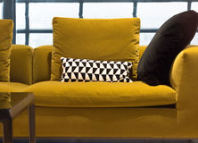 Contemporary Sofa. Mustard Color Contempoary Sofa with Stylish Cushions Stock Image