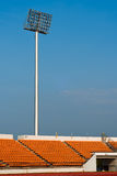 Contemporary stadium Orange seat light and track Stock Photography