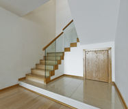 Contemporary stair case. With wooden steps and glass rails Royalty Free Stock Photos