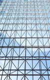 Contemporary steel structure and transparent glass roof. Revealing blue sky with light clouds Royalty Free Stock Photo
