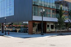 Contemporary street corner exterior building. Contemporary exterior design details and elements of a modern building. Public architecture on an urban city street Royalty Free Stock Photography