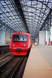 Contemporary train station. Train station with red electric train Stock Photos