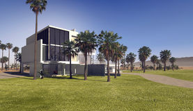 Contemporary upmarket tropical villa. With rectangular whitewashed walls and a flat roof in extensive grounds with landscaped lawns and palm trees stock photography