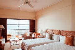Contemporary vintage hotel room with chair and table with ocean Stock Image