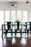 Contemporary vintage styled light bright dining room with bifold. Doors vertical Stock Images