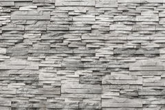 Contemporary wall of light grey, natural stone. Texture Stock Photos