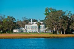 Contemporary Waterfront Mansion Royalty Free Stock Image