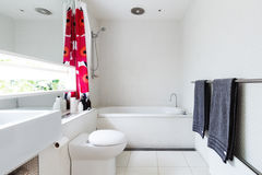 Contemporary white bathroom of mosaic and terrazzo tiles with re Royalty Free Stock Photo