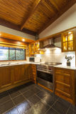 Contemporary wooden kitchen Royalty Free Stock Image