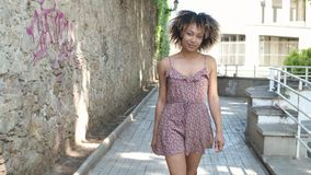 Contemporary young woman in dress on street stock video