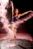 Contemporary ballet pose pink powder Stock Photo