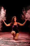 Contemporary dance girl throwing pink powder stock photography