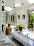 Contempory bathroom. White contempory bathroom with mirror Royalty Free Stock Photos