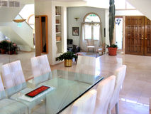 Contempory dining room. With glass table Stock Images