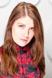 Contemptuous look beautiful brunette in studio Royalty Free Stock Image