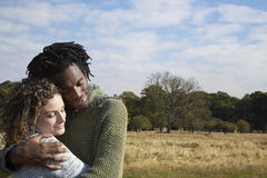 Contended Couple Embracing In Field Stock Images