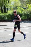 Contender dressed in black competing in the Marathon race royalty free stock photos